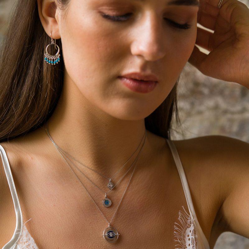 The Navajo Earrings, The Wayfarer Spinner Necklace, The Nazar Coin Necklace & The Nomad Necklace In Pink Moonstone