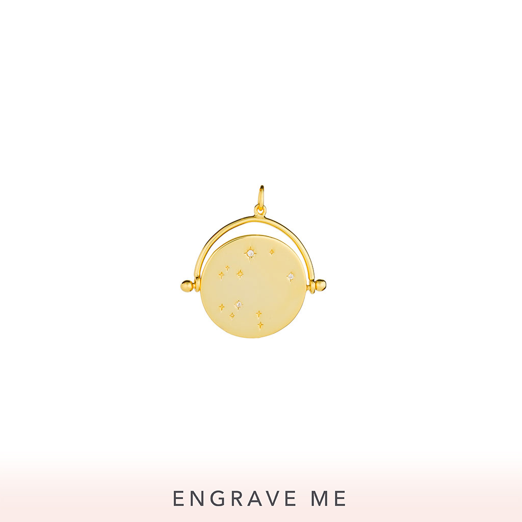 The Cosmos Spinner Charm In Yellow Gold.